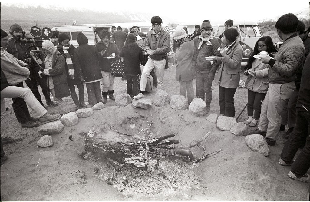 People gathered around a bonfire during the 1969 Manzanar Pilgrimage.